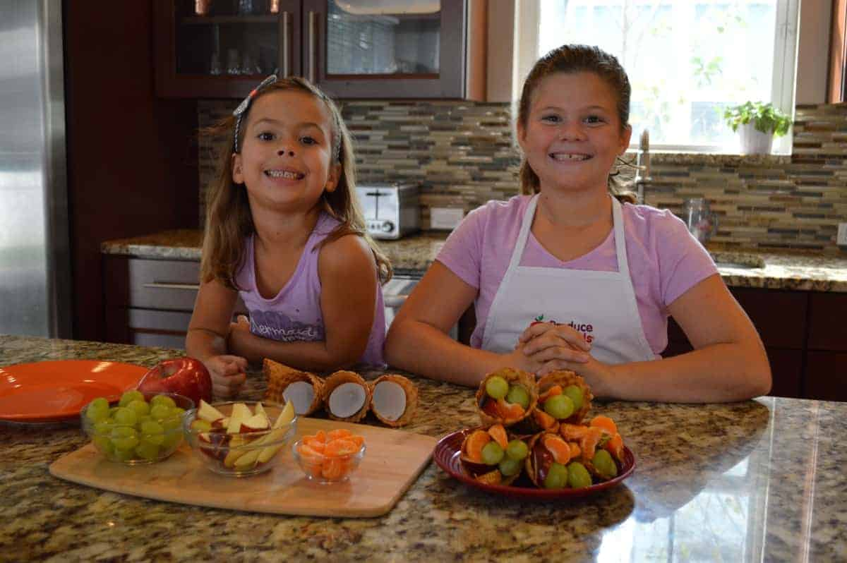 the kids making fruit cornucopias
