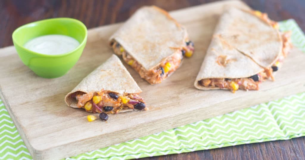 Chicken quesadillas on cutting board
