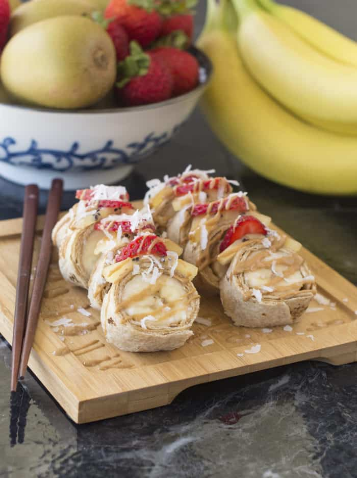 Banana sushi plated on bamboo plate with chopsticks