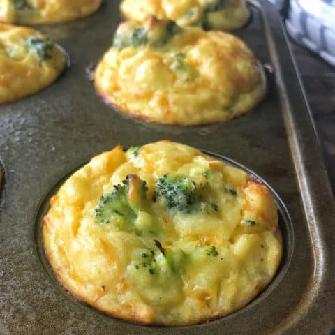 Baked Cheesy Mashed Potato Bites - What is more comforting than mashed potatoes? How about Baked Mashed Potatoes loaded with cheese, broccoli, baked into delicious mashed potato bites that have kids happily eating their vegetables for dinner!