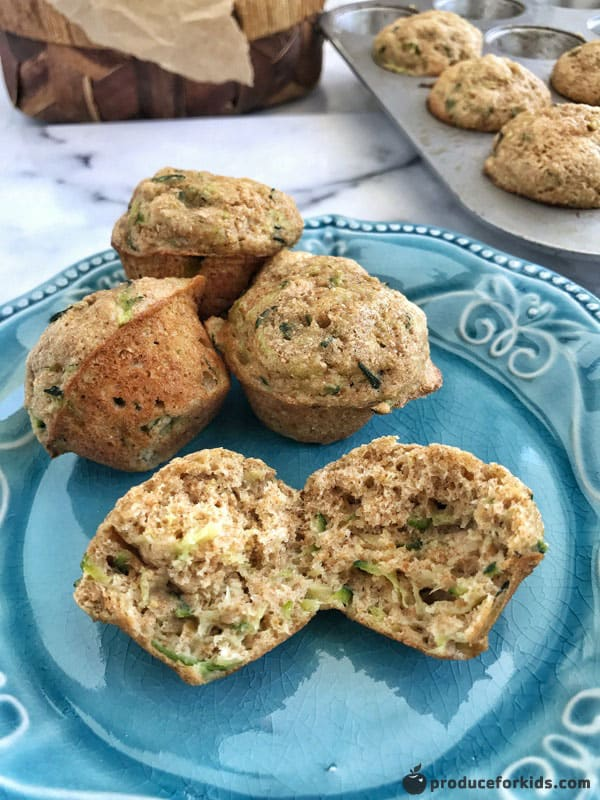 Mini Zucchini Bread Muffins are the perfect after-school snack. Made with whole wheat flour, applesauce rather than oil, and a veggie, they are a healthy snack any time of the day. They also freeze well and are the perfect grab-and-go snack.