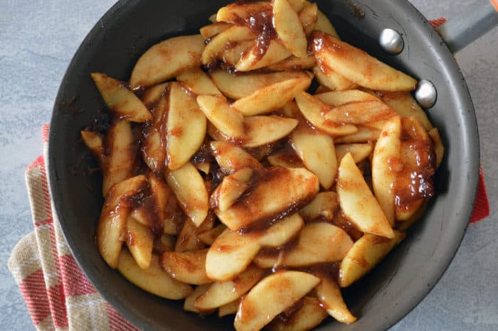 Cinnamon apples cooking in skillet