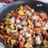 Cheesy Smoked Sausage and Red Potato Skillet