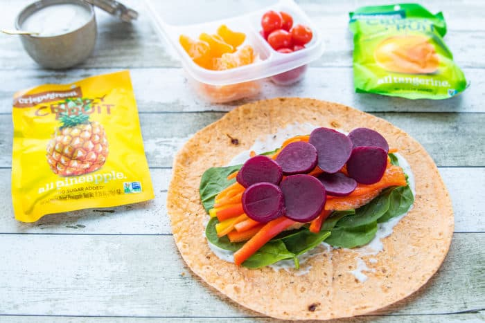 Rainbow Veggie Wraps layered on tortilla