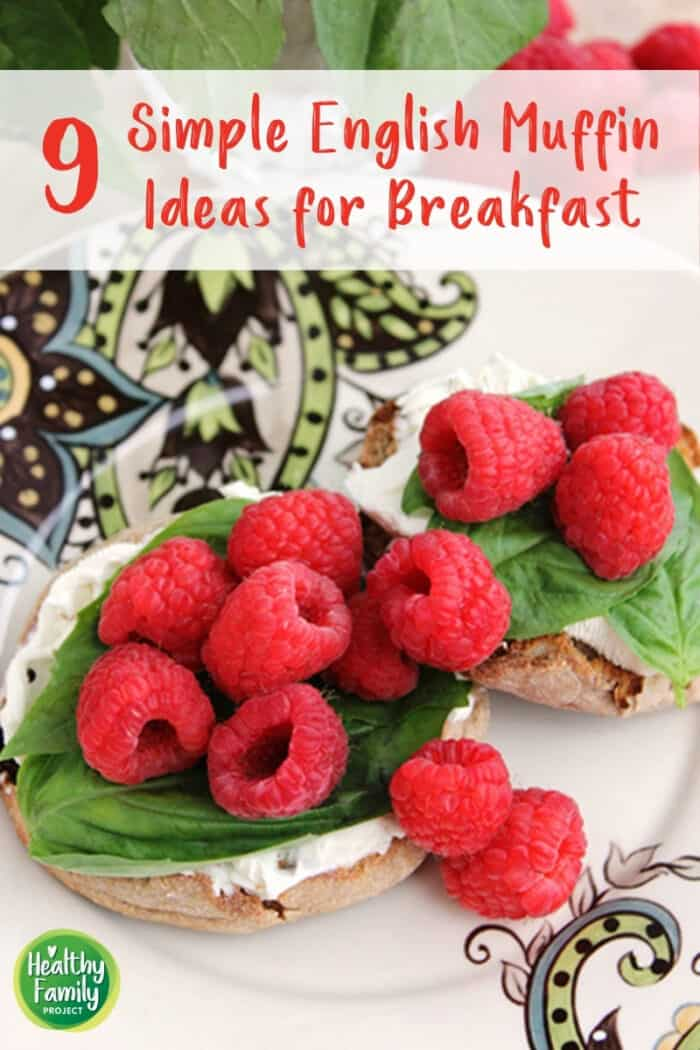 English muffins topped with cream cheese, fresh basil and raspberries.