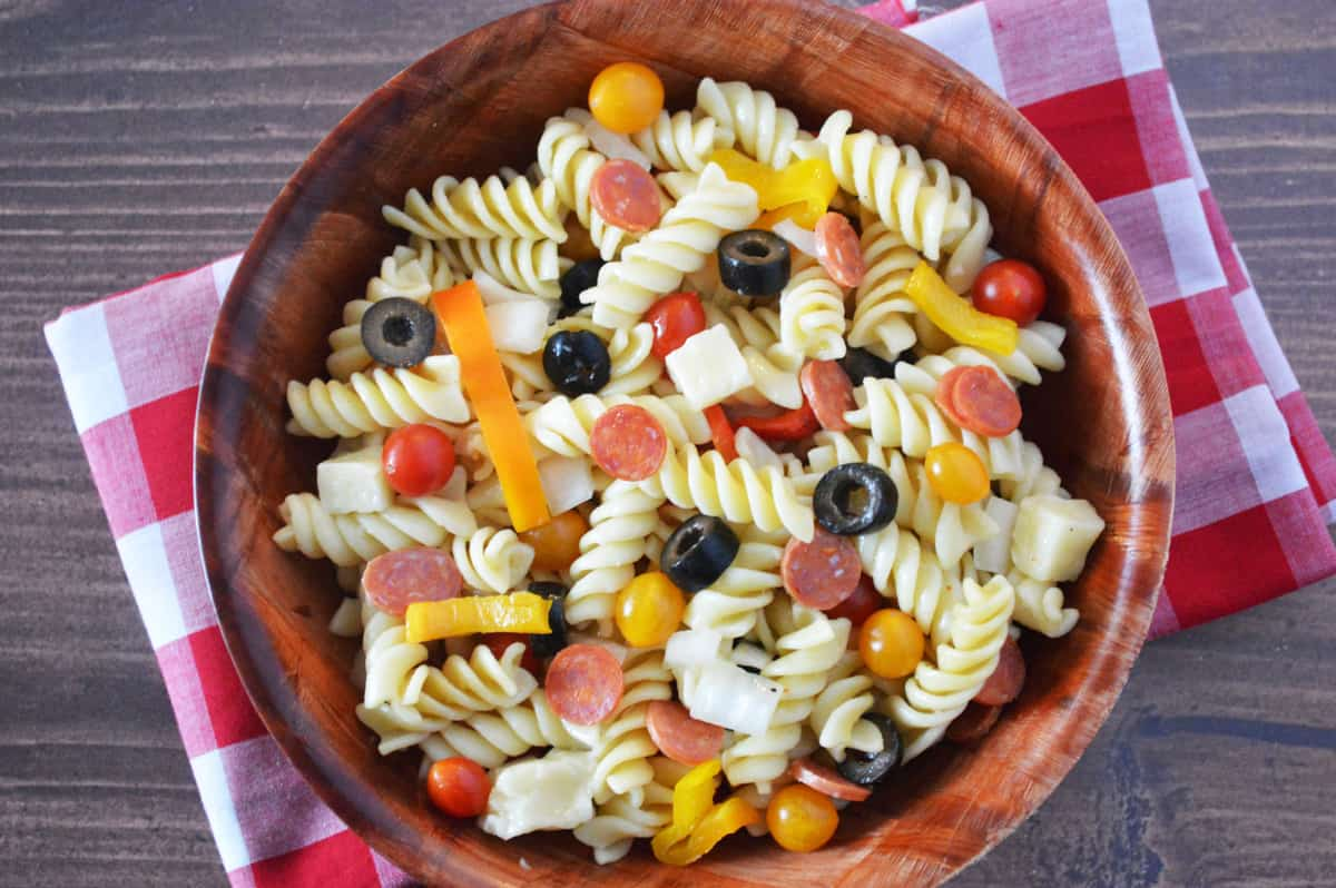 easy Pizza Pasta Salad in wooden bowl