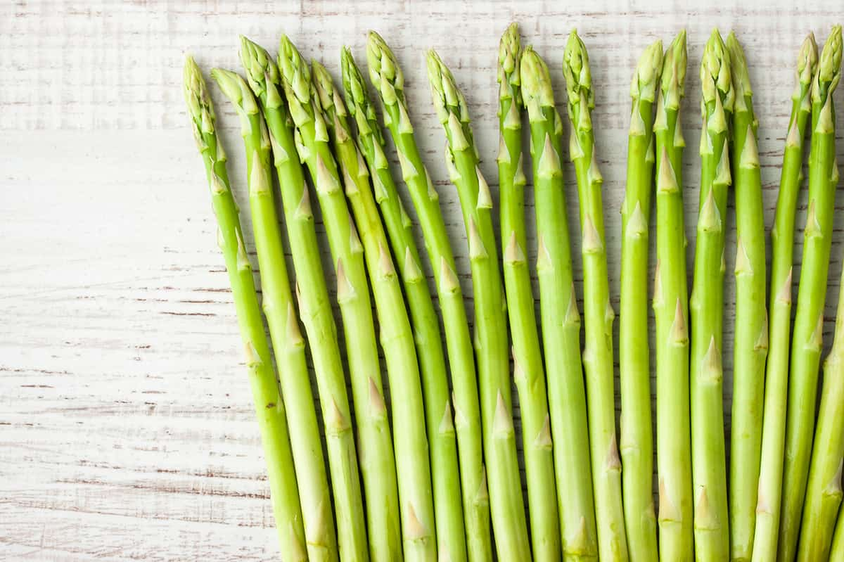 Sprigs of asparagus on the white table