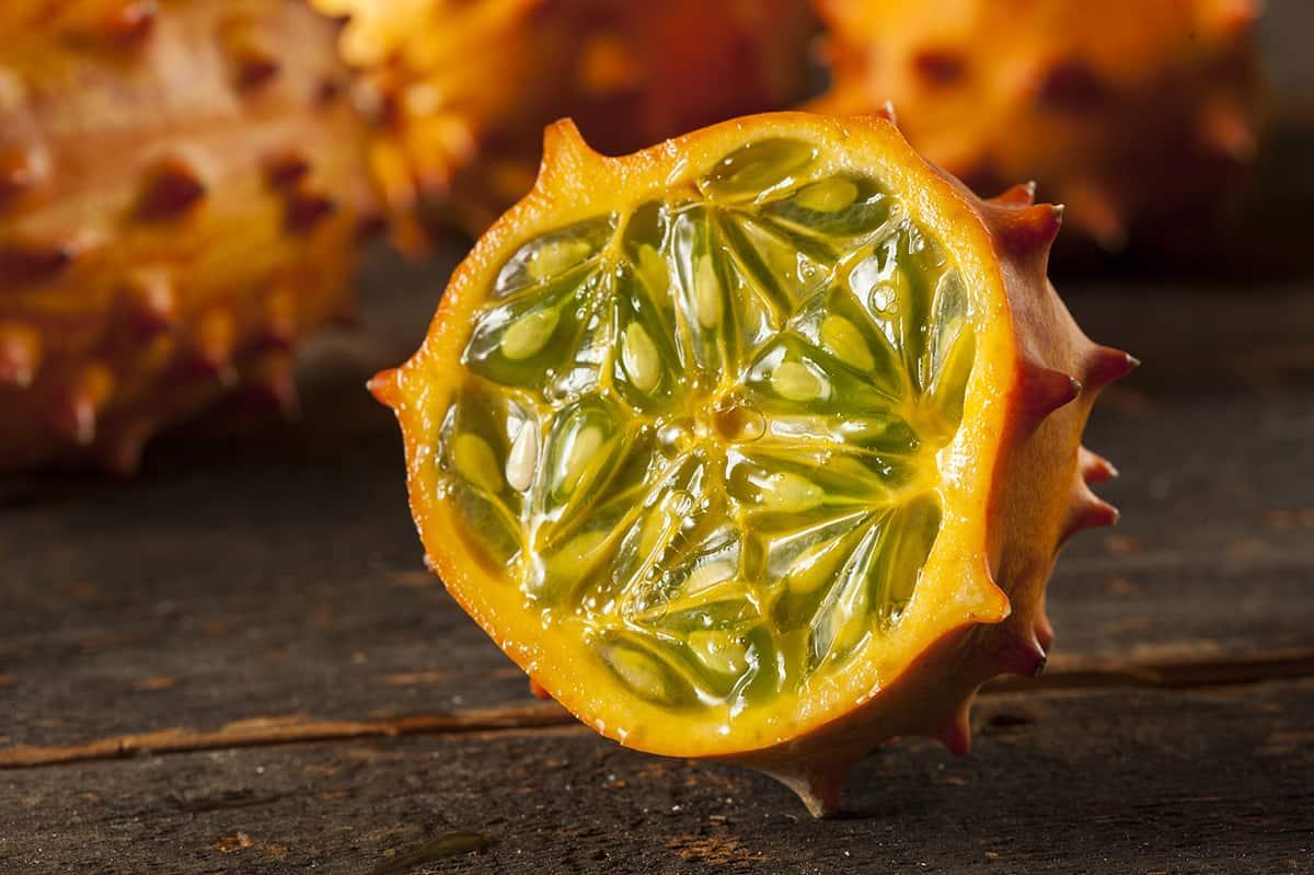 close up of kiwano melon cut in half