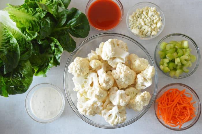 Ingredients for buffalo cauliflower wrap in bowls
