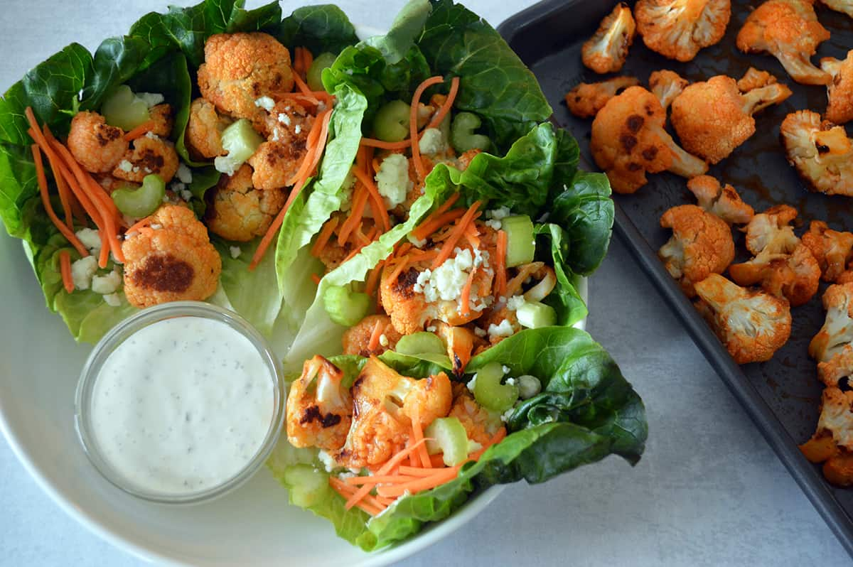 plate of buffalo cauliflower lettuce wraps with ranch for dipping