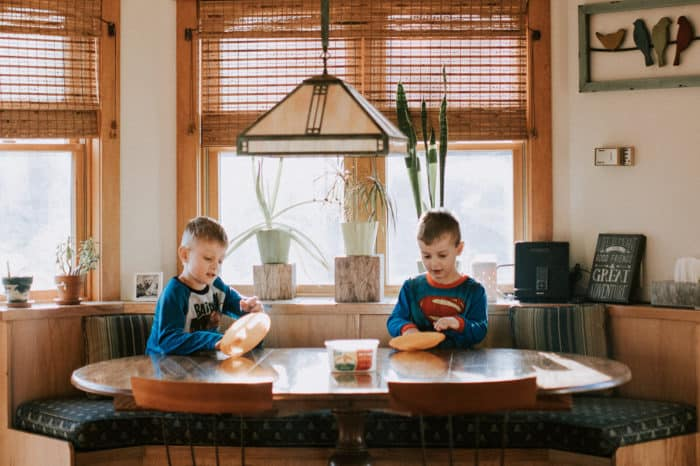 boys sitting at dining room table