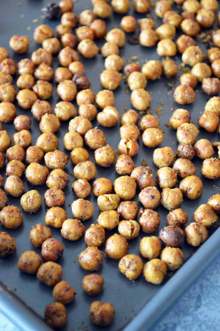 Close up of roasted chickpeas on baking sheet
