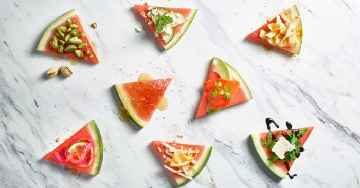 Slices of watermelon on marble background.