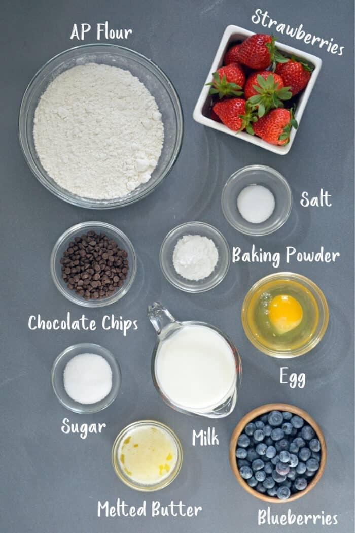 Ingredients for sheet pan pancakes laid out in bowls.