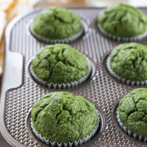 Close up of green spinach muffins in muffins tin.