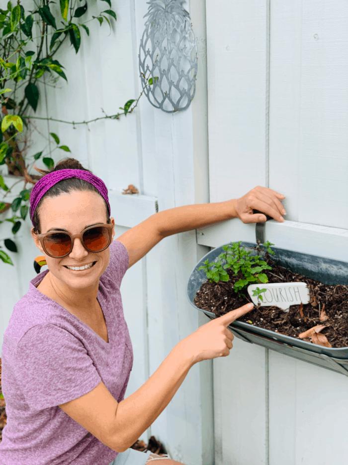 Woman working in her herb garden.