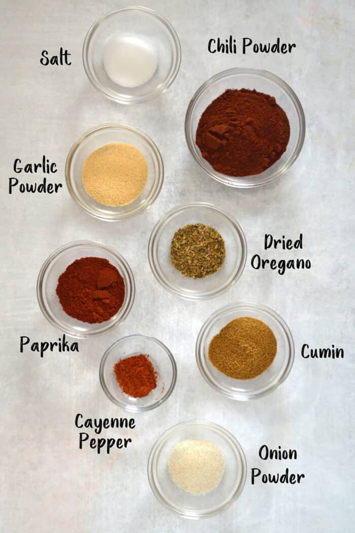 Ingredients for taco seasoning in individual bowls.