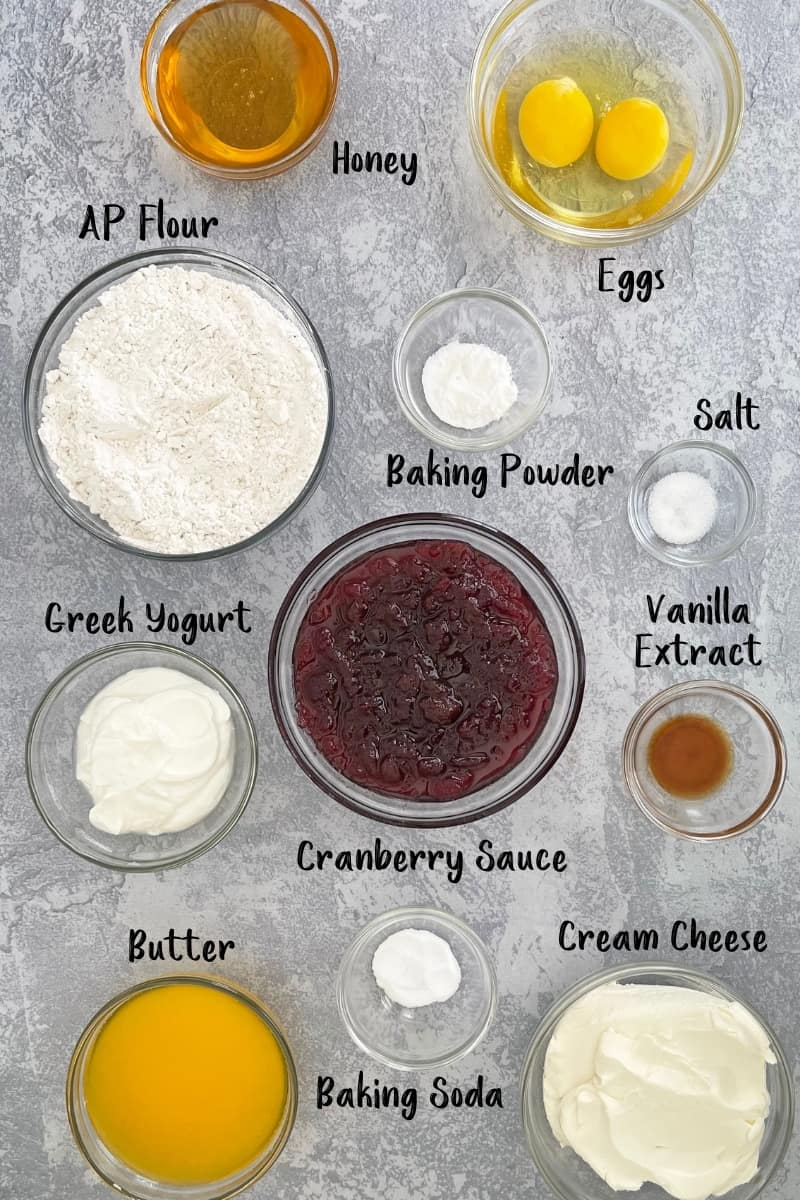 Overhead of cranberry cupcakes ingredients in individual bowls.